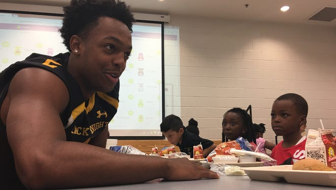 Central Gwinnett High quarterback and Kentucky Wildcats commitment Jarren Williams eats lunch with Jenkins Elementary School students in Lawrenceville, Georgia on Tuesday, August 29, 2017.