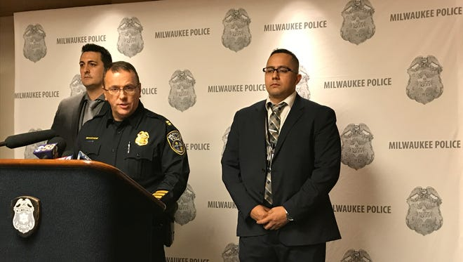 Milwaukee Police Capt. William Beauchene (center) on Thursday discusses arrests made in a robbery spree with Detectives Chris Schlachter (left) and Rudy Alvarado.
