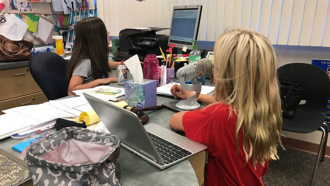 These students at Palm Desert Charter Middle School work on a digital storytelling project.