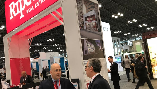 Curtis Nassau of the Lyndhurst office of Ripco Real Estate, at the start of the two-day deal-making conference at the Javits Center.