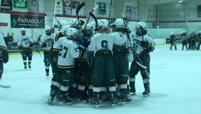 Members of the Passaic Valley-Cedar Grove hockey team come together to celebrate a state tournament victory, the first for the program since 2010.