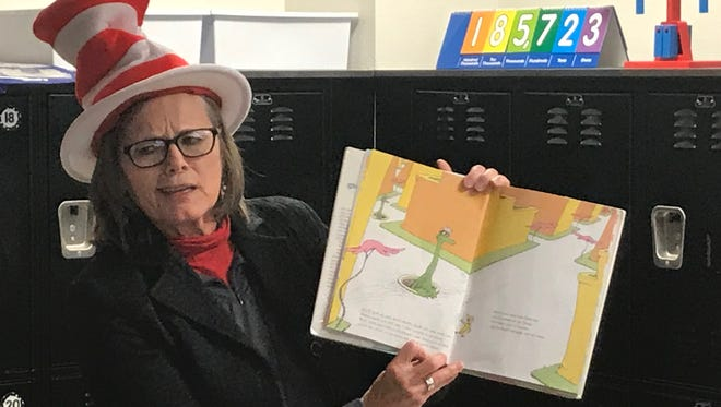 "Carla Garrett, executive director of elementary education for the Abilene Independent School District, reads Dr. Seuss's ""Oh the Places You'll Go"" to third-grade students at Martinez Elementary School on Friday, March 2, 2018."