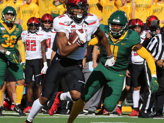 Texas Tech wide receiver Erik Ezukanma (84) runs past Baylor cornerback Jameson Houston (11) during the first half of a NCAA college football game in Waco, Tex.,Saturday, Oct. 12, 2019.(AP Photo/Jerry Larson)
