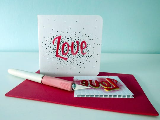 This Monday, Feb. 6, 2017, photo taken in Hopkinton, N.H., shows a Valentine's Day card and the handmade stamp used to decorate it. Using a craft knife to cut shapes out of inexpensive foam sheets is any easy way to create a customized stamp.
