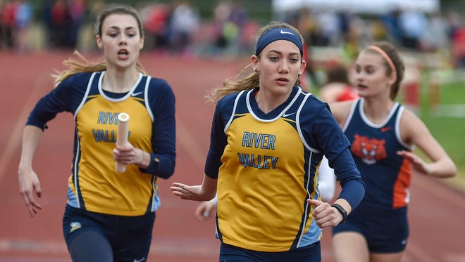 River Valley's Olivia Kyrk hands off the baton to Makenzie Wollett in the MOAC Red Division 4x200 relay Thursday night at Pleasant. The Vikings won the league title for the first time since 2013.