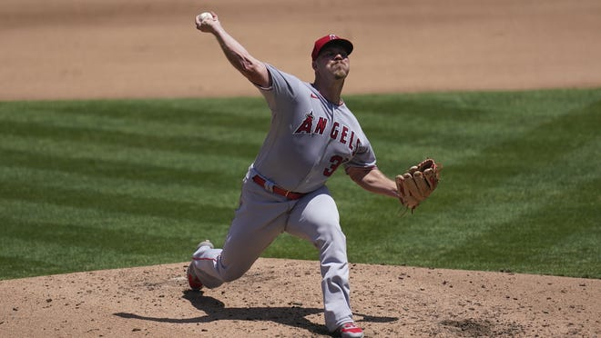 Los Angeles Angels pitcher Dylan Bundy throws against the Oakland Athletics during the fourth inning of a baseball game in Oakland, Calif., Saturday, July 25, 2020.
