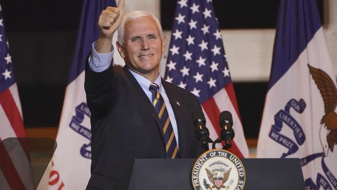 Vice President Mike Pence gives a thumbs up signal at the conclusion of a Make America Great Again event in Carter Lake, Iowa, Thursday.
