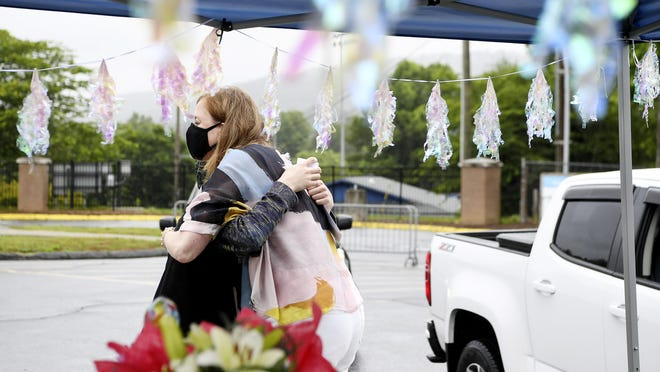 """Noah Trexler hugs his former principal, Shannon Auten, before giving her a heartfelt thanks Tuesday at West Henderson High School. """"You helped bring me to a community where I could really grow,"""" he told her."""