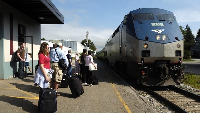 Passengers wait to board the Amtrak train in Essex Junction.