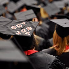A graduating student's decorated mortarboard stands out during the undergraduate commencement ceremonies.