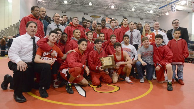 Paulsboro wrestlers celebrate after defeating Emerson Park Ridge in the the NJSIAA Group 1 State Championship at Toms River North High School on Sunday. 02.11.18