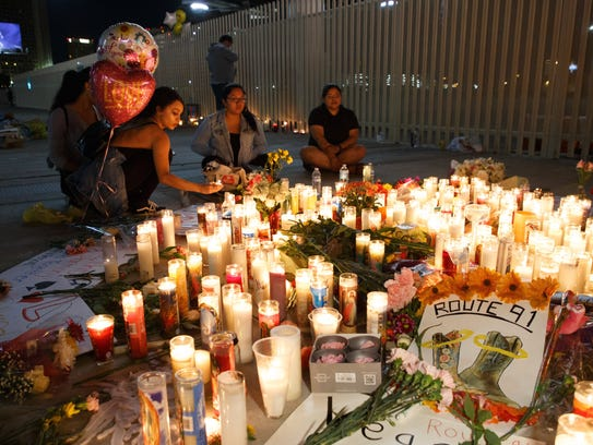 Mourners pay tribute at a makeshift memorial on the