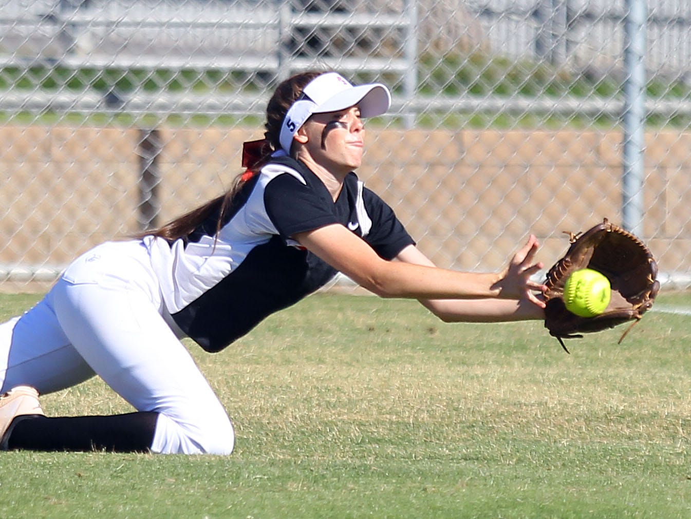 Palm Springs' Kalynn Bedwell makes a catch in right field against Palm Desert on Friday, March 25, 2016 in Palm Desert.