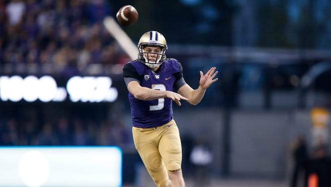 Washington quarterback Jake Browning tosses a pass during a win over Stanford.