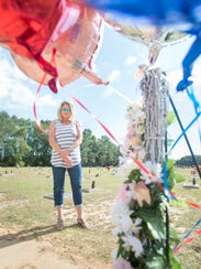 Chris Bellas looks over the grave of 9-year-old Dericka