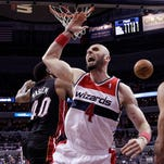 Washington Wizards center Marcin Gortat reacts after a blocked shot by Miami Heat forward Udonis Haslem on Monday. The Wizards won 114-93.