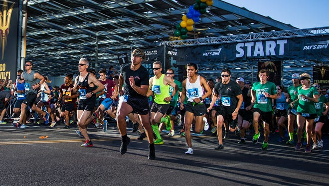 Runners take off at the start of the 12th Annual Pat's Run at Sun Devil Stadium early Saturday morning, April 23, 2016.