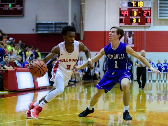 Bosse's Mekhi Lairy (2) dribbles around Memorial's