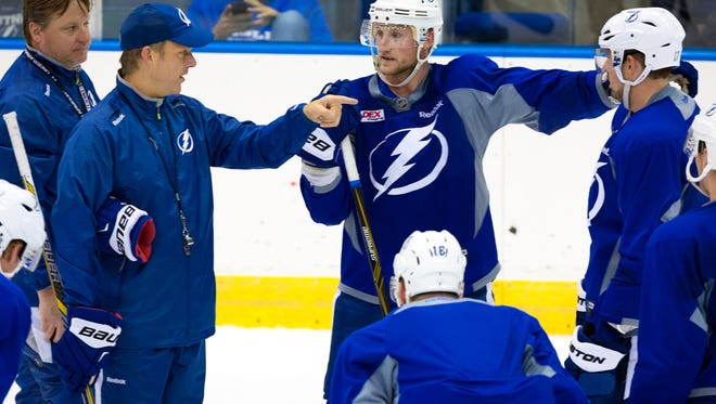 Tampa Bay Lightning head coach Jon Cooper, second from left, and captain Steven Stamkos talk during practice at Germain Arena on Monday, Oct. 5, 2015, in Estero. The Stanley Cup runner-up Tampa Bay Lightning held a final practice at Germain Arena Monday to cap a three-day stay in Southwest Florida.