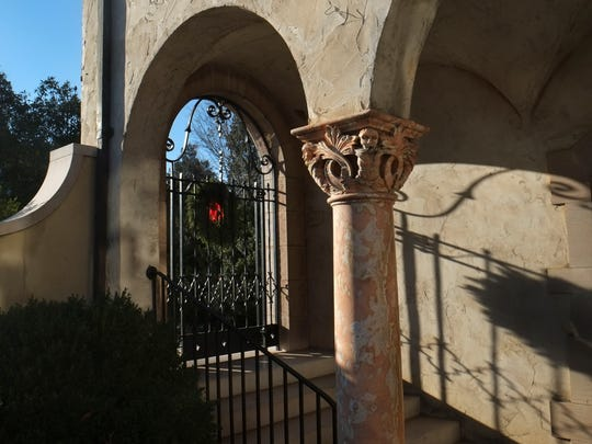 A gate and stairs lead to the courtyard and main entry of the Craiglen house.