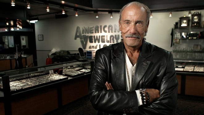 Les Gold stands inside the pawnshop American Jewelry & Loan in Detroit.