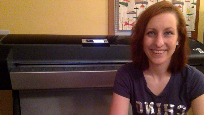 Allyson Bousema, owner of Prints & Repeat, with her new printer.