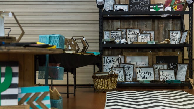 The Saturday Shoppe's market space, a local shop run by Sara Price. She and her husband design and craft wooden pieces along with tshirts, hats, pillows, and waterbottles.