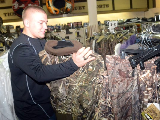 ANI Shopping after Christmas Joseph Thibodeaux (pictured) and his father James Thibodeaux were looking for a jacket for Joseph at Security Sporting Goods Friday, Dec. 26, 2014.-Melinda Martinez/mmartinez@thetowntalk.com