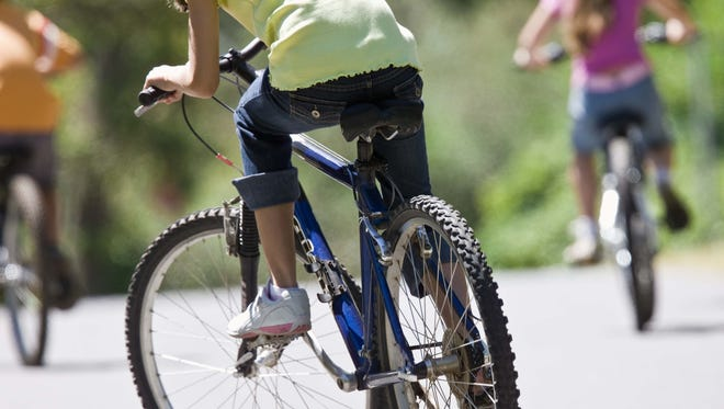 Kids mastering the art of bike riding is pretty sweet, Momsense columnist Sara Paulson writes. FLORIDA TODAY file