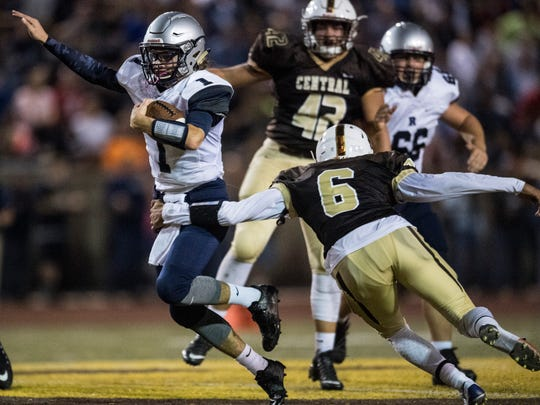 Reitz Quarterback Eli Wiethop (1) dodges an attempted tackle by CentralÕs Jamir Simpson (6) as he runs downfield at Central Stadium in Evansville, Ind., on Friday, Sept. 8, 2017. The Panthers defeated the Bears, 28-21.