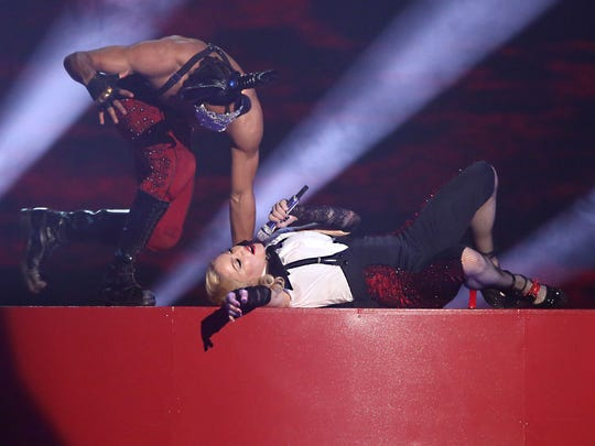 Madonna lies onstage at the Brit Awards, where she