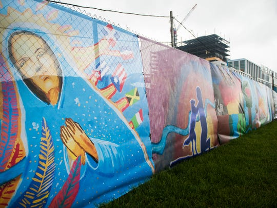 "A unveiling ceremony took place Friday morning for a 685-foot mural entitled ""Camden, Past. Present. Future."", that was created by Camden students and is displayed on the construction fencing at the Camden Waterfront development site."