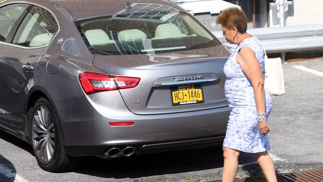 Mount Vernon Deputy Recreation Commissioner Diane Atkins walks to her Maserati outside City Hall.
