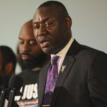 Lawyer Benjamin Crump assists Lesley McSpadden, mother of slain 18-year-old Michael Brown, during a press conference Aug. 11, 2014, at Jennings Mason Temple Church of God In Christ in Jennings, Mo.