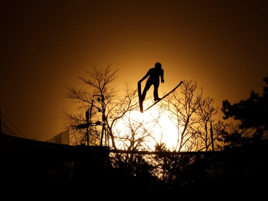 Laurent Muhlethaler, of France, is silhouetted as he jumps during training for the nordic combined competition at the 2018 Winter Olympics in Pyeongchang, South Korea, Sunday, Feb. 18, 2018. (AP Photo/Dmitri Lovetsky)