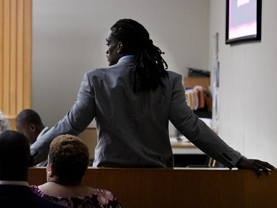A.J. Johnson waits for court to start for jury selection