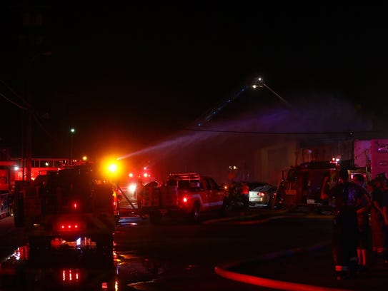 Firefighters from multiple agencies battle a large