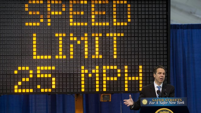 Gov. Andrew Cuomo speaks Saturday at a bill signing in New York to lower the city speed limit to 25 mph.