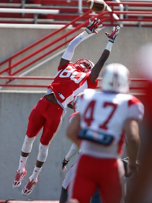 Miami University wide receiver David Frazier gets up to make a reception during practice at Yager Stadium in April.