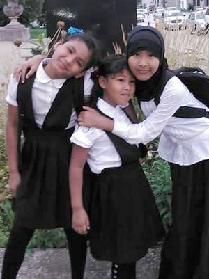 Alia, right, with her sisters in front of the Detroit International Academy for Young Women. Left to right: Ambiya Adan, Yasmin Adan and Alia Adan