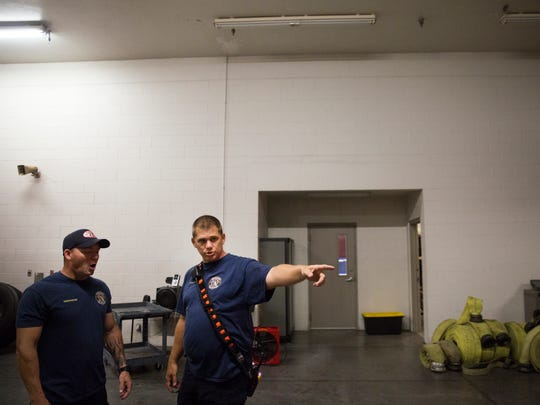 Capt. Jason Sellers directs firefighters where to move equipment on Saturday, Sept. 9, 2017, at the Greater Naples Fire Rescue Station 72 as Hurricane Irma makes its way toward Southwest Florida. The firefighters made final adjustments to makes sure that gear and vehicles were in the proper place to deploy after the storm.