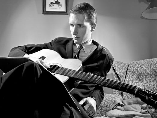 "George Hamilton IV, who gave up popular music for the ""Grand Ole Opry,"" thoughtfully studies a song he will present at East High School's talent show on April 13, 1961. Hamilton will be one of the guest stars at The Nashville Tennessean-sponsored talent hunt."