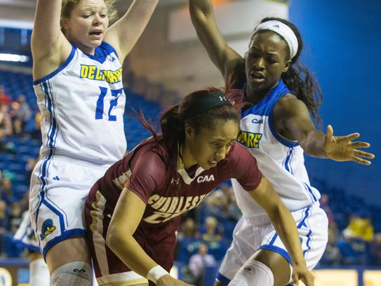 The University of Delaware's Lizzie Oleary (12) and Nicole Enabosi (33) surround the College of Charleston's Deja Ford at the Bob Carpenter Center.