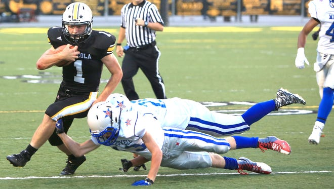 Caleb Ferguson and Tuscola lost 35-20 at home to McDowell in 2015. The same teams play Friday in Marion.