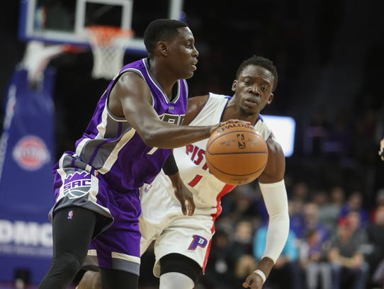 Pistons guard Reggie Jackson defends Kings guard Darren