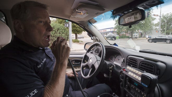 Loveland Police Department Sgt. Bob Shaffer calls in to respond to a domestic disturbance where three people were reported to be fighting, on Friday, July 21, 2017, in downtown Loveland. Three other officers also responded to the scene.