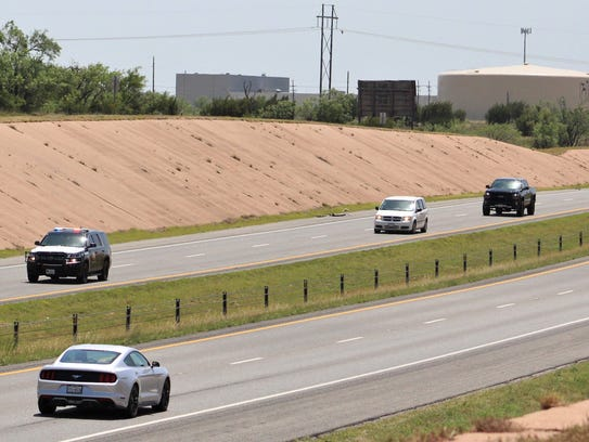 A DPS vehicle leads a procession, including a vehicle carrying the body of fallen firefighter Richard Loller Jr., that passes through Abilene on Monday afternoon. Local firefighters and other first responders lined overpasses to honor Loller, a 13-year veteran.