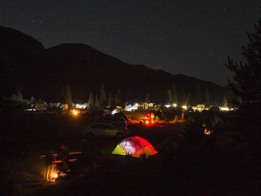 Camp fires glow under the stars at the Timber Creek