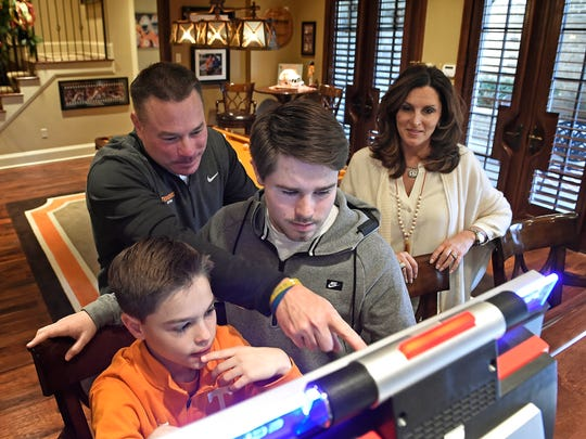 Butch Jones watches over his sons Andrew, left, and
