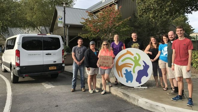 Nine of the 10 Zoo Knoxville employees who volunteered to help clear limbs and other debris caused at a Florida great ape sanctuary by Hurricane Irma. They're posing at the zoo before their 14-hour trip on Monday, Sept. 25.